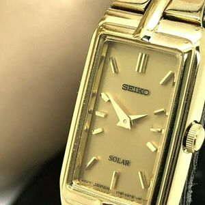 SEIKO SOLAR CHAMPAGNE DIAL GOLD TONE LADIES WATCH MODEL